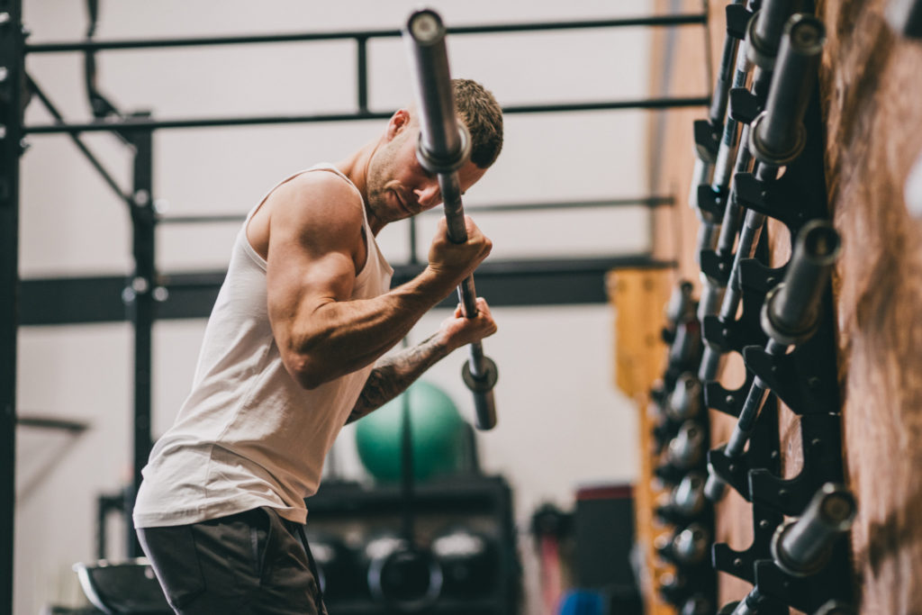 Cody barbell curling.