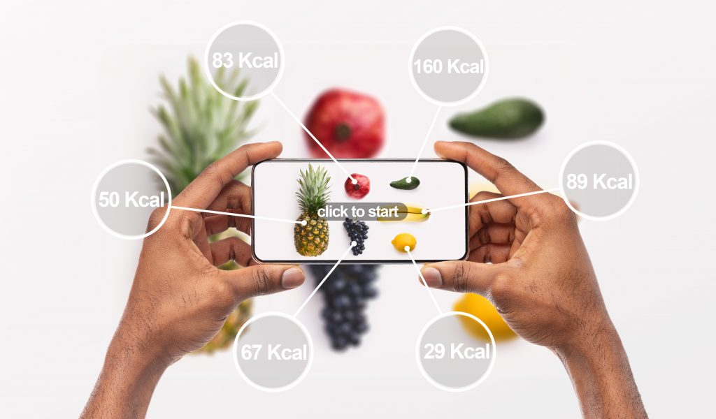 Woman holding cellphone with application which counting calories by photo, background, panorama