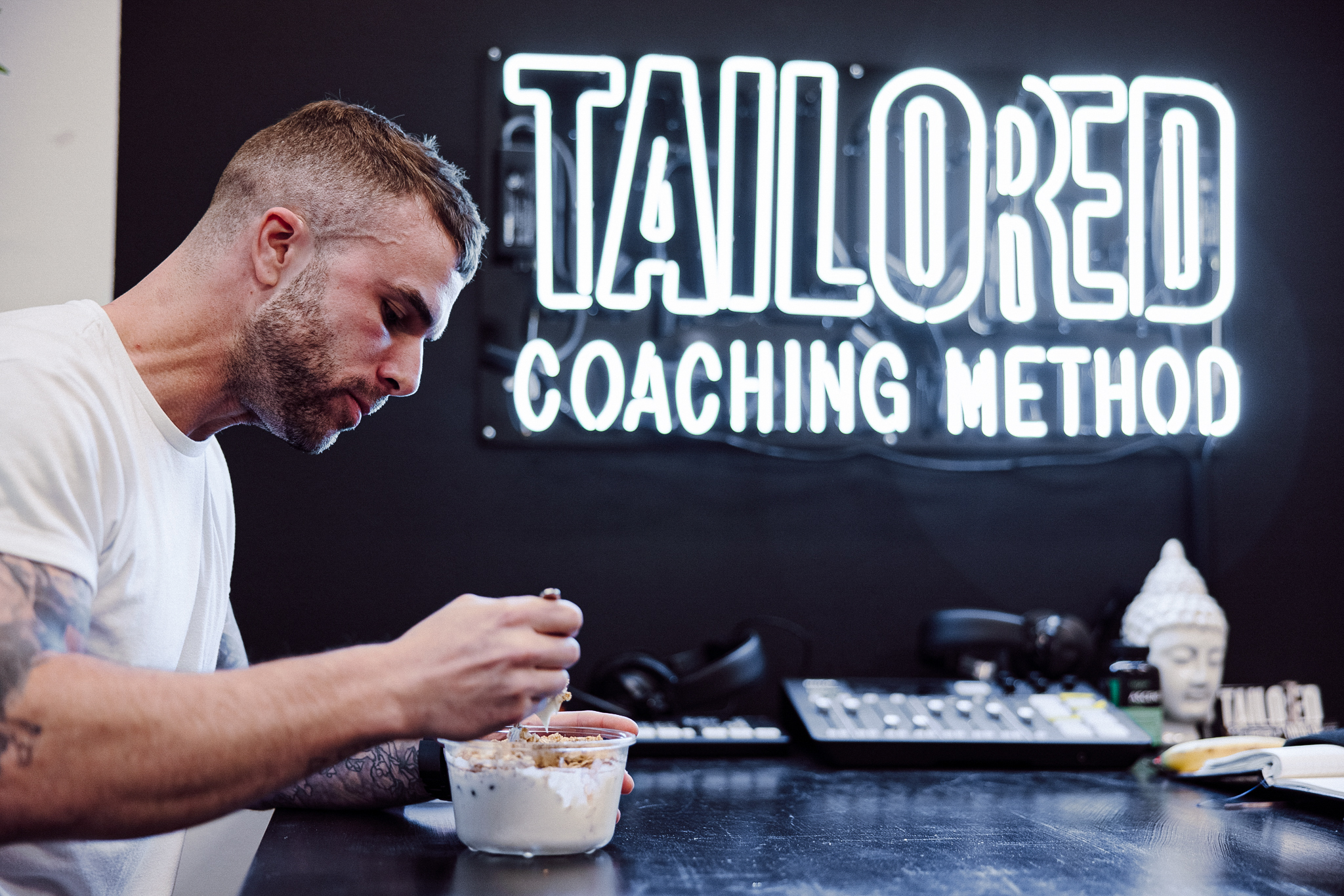 Coach Cody eating a prepped meal at Tailored HQ